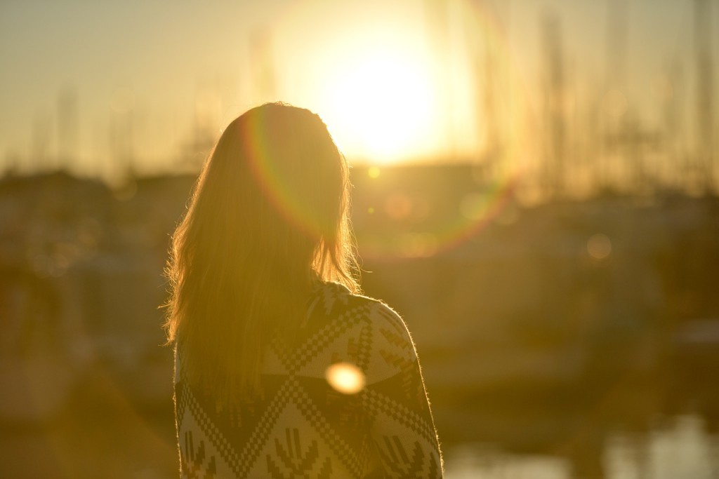 vrouw zon